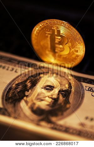 Single Bitcoin Coin Or Icon Standing In Sharp Focus On A Reflective Surface