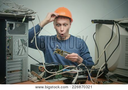Surprised Computer Technician Engineer Is Shocked From New Computer Video Card Which Hi Holds In Han