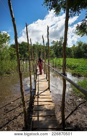 Wooden Bridge Connecting Champa Village To River In Mekong Delta, Vietnam. Champa Girl Walking On Br