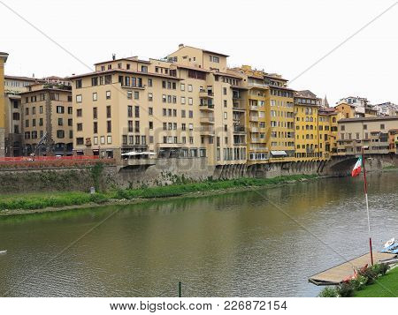 14.06.2017 Florence, Italy: View Of Medieval Stone Bridge Ponte Vecchio And Arno River