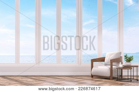Modern Living With Sea View 3d Rendering Image.the Rooms Have Wooden Floors .furnished With Wood And