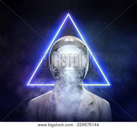 Male In Astronaut Space Helmet Smoking Electronic Cigarette Over Blue Neon Hipster Triangle Backgrou