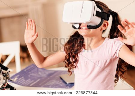 It Cant Be Real. Amazed Preteen Child Gesturing And Smiling Cheerfully While Wearing A Vr Headset In
