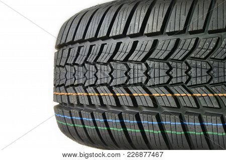 Tire Tread. High Performance Modern Car Wheel Of Rubber Or Caoutchouc Close Up