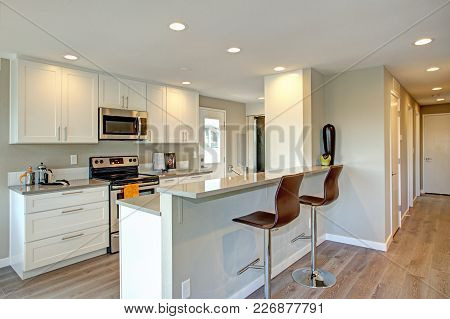 Light Filled Kitchen With White Cabinets