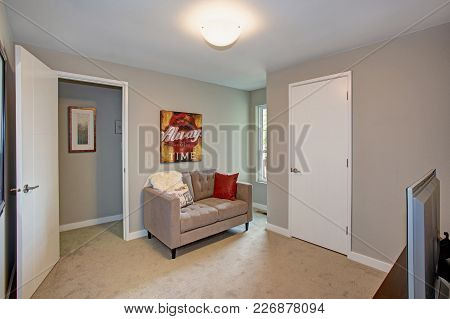 Gray Room With Sofa And Tv.