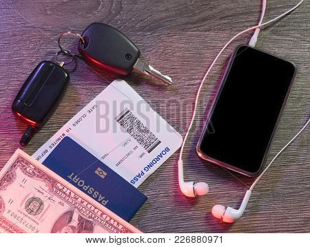 Dollars, Mobile Phone, Passport, Keys To The Car, Boarding Pass