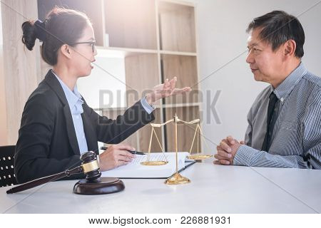 Having Meeting With Team At Law Firm, Consultation Between A Female Lawyer And Businesswoman Custome
