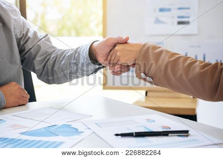 Two Business People Shaking Hands During A Meeting To Sign Agreement And Become A Business Partner I