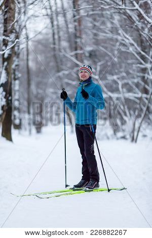 Photo Of Male Skier In Blue Jacket At Winter Forest During Day