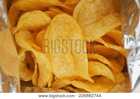 Potato Chips In A Silver Package. Close Up.
