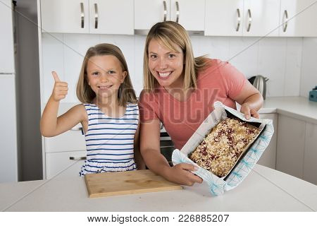 Young Mother And Her Sweet Beautiful 7 Years Old Daughter Giving Thumb Up Showing Proud Strawberry C