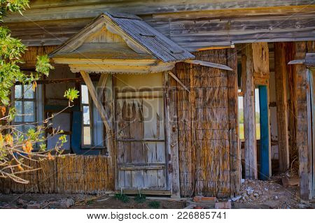 An Old Abandoned Wooden House With Walls Made Of Straw. Astrakhan Region. Russia. Hdr Photo With Pos