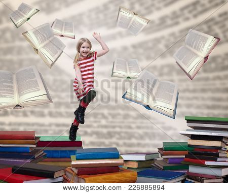 Happy Child Jumping Out Of The Books. The Concept Of Education And Reading.
