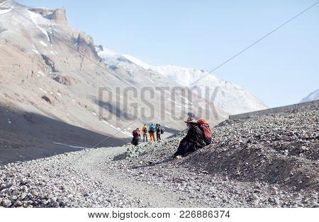 Ngari, Tibet - May 5, 2014: Young Tibetan Porter On The Trail Around Sacred Mount Kailash In Tibet A