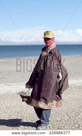 Ngari, Tibet - May 7, 2013: Young Tibetan Pilgrim In National Clothes On The Trail Around Holy Manas