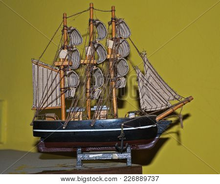 Miniature Model Of Sailing Ship On Dirty Table