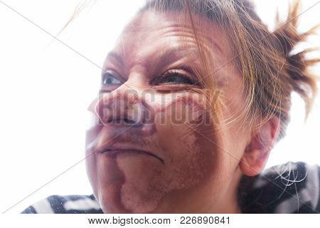 Funny Woman Smashed Against Pane