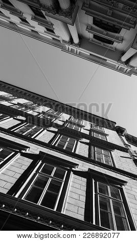 Classical Building Facades, Narrow Street Of Vienna, Austria. Architectural Background Black And Whi
