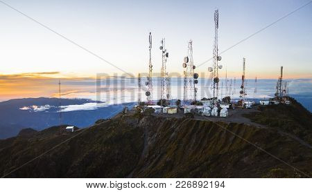 An Array Of Communications Towers Sits On Top Of Volcan Barú, Panama's Highest Point, As Seen At Sun