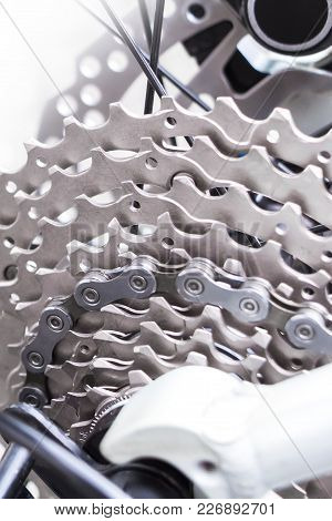 Bicycle Gear, Disk Brake And Metal Chain Rings Detail, Close Up Shot Of A Black Hydraulic Mountainbi