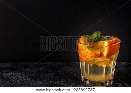 Orange Homemade Cocktail/detox Fruit Infused Water, Selective Focus.