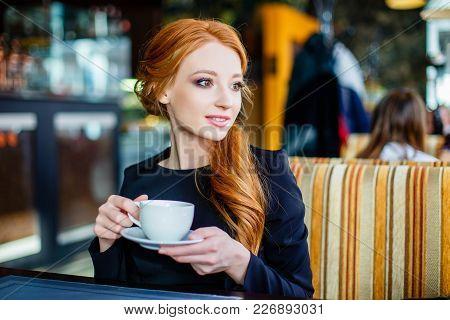 Pretty Young Girl In Cafe. Pretty Young Girl In Cafe