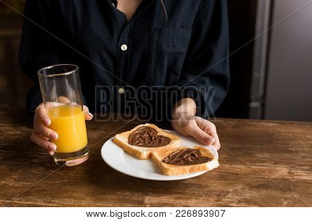 Cropped Image Of Girl Holding Plate With Toasts With Hearts From Chocolate Paste, Valentines Day Con
