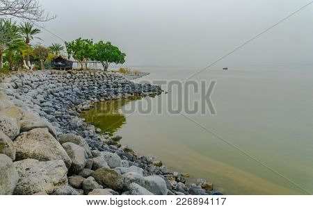 View Of The Eastern Shore Of The Sea Of Galilee, In Ein Gev, On A Foggy Day, Northern Israel
