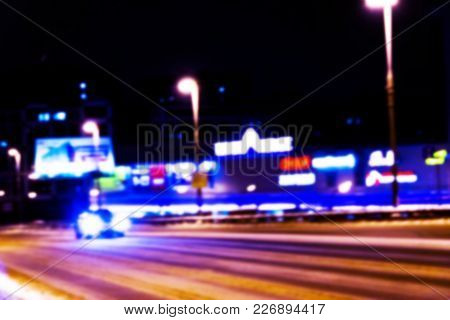 Night City View In Blur. City Speed Traffic Lights Blurry Photo. Street Life Bokeh Image. Street Wit