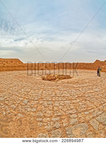 Yazd, Iran - May 4, 2015: Tourists Sightseeing The Central Pit Of The Tower Of Silence.