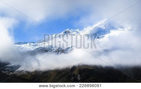 Mt. Aspiring Is Seen Through A Gap In The Clouds In The Mt. Aspiring National Park, New Zealand.