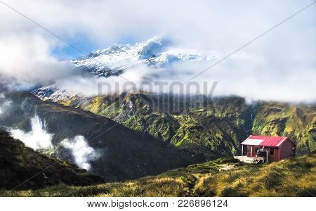 Liverpool Hut Sits On The Edge Of A Large Cliff In The Matukituki Valley With An Excellent View Of M