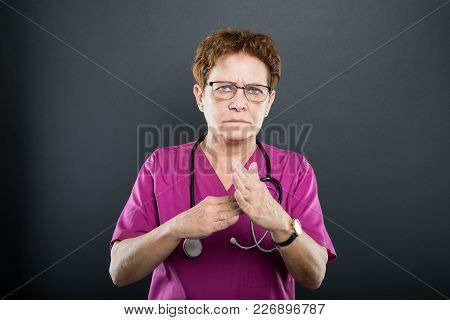 Portrait Of Senior Lady Doctor Showing Time Out Gesture
