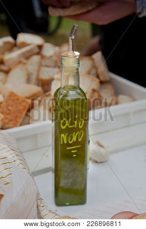 Bibbona, Tuscany, Italy, After The Olive Harvest A Bottle Of New Oil (olio Novo)