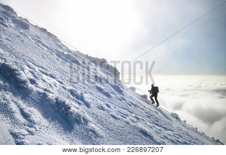 A Climber Rises Above The Cloud Layer As They Make The Journey Up Ngauruhoe, A Mountain On The North