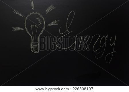 Drawn Light On Blackboard With The Text: Energy