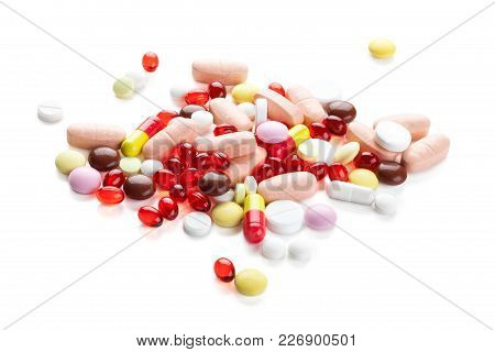 Closeup Shot Of Red Capsules And Colorful Pills. Isolated On White Background.