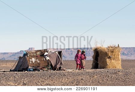 Sahara, Morocco - January 6, 2014: Bedouins Children Playing At The Camp In Western Sahara Desert, A