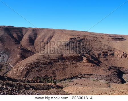 Rocky Canyon In Atlas Mountains Range Landscapes In Southeastern Morocco Near Old Village Of Oulad A