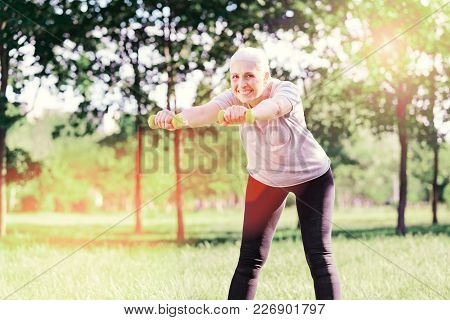 Healthcare. Cheerful Elderly Woman Standing In Front Of You While Bending Forward And Keeping Weight