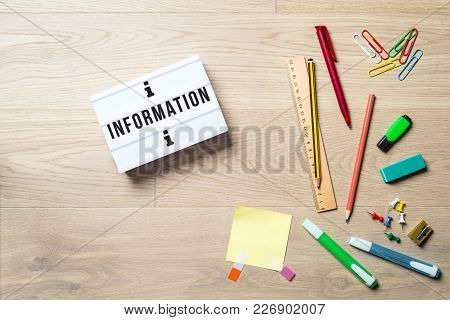 Information Writing In Lightbox With Pen, Pencil, Highlighter And Ruler Lying On Office Desk As Flat