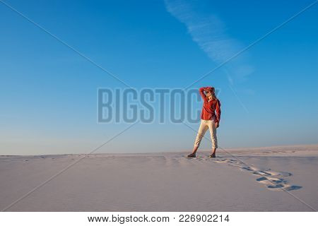 Dreaming Young Woman, Blonde Posing In The Desert On The Background Of The Blue Sky, Enjoying Life A