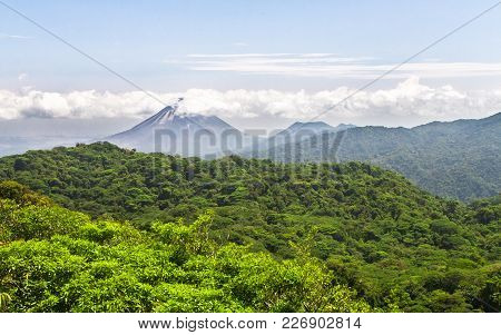 Volcan Arenal Dominates The Horizon Above The Dense Jungle In Central Costa Rica.