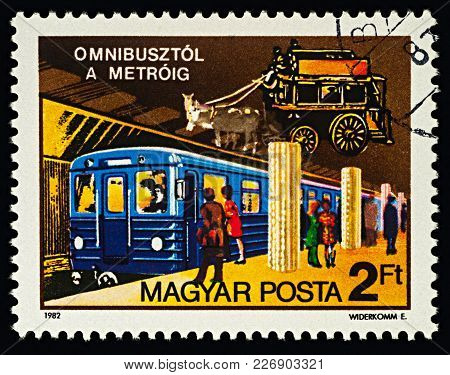 Moscow, Russia - February 16, 2018: A Stamp Printed In Hungary, Shows Subway Train And Horse Carriag