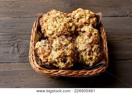Oats Cookies In Bread Basket On Wooden Table. Close Up View