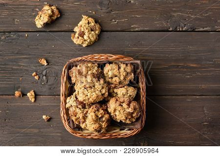 Healthy Oats Cookies In Bread Basket Over Wooden Background. Top View, Flat Lay
