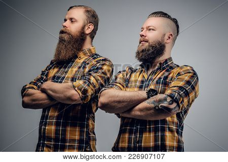 Two Bearded Hipster With Crossed Arms On Their Chests Dressed In A Yellow Shirt