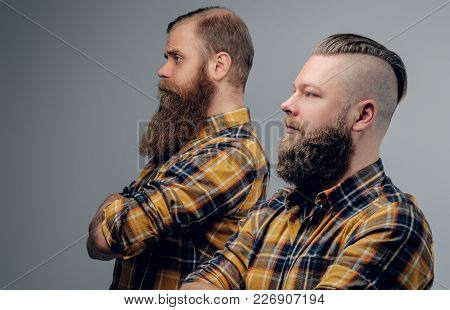 Two Bearded Hipsters Dressed In A Yellow Plaid Shirt Isolated On Grey Vignette Background.