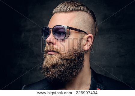 Close Up Studio Portrait Of Bearded Male In Fashionable Purple Sunglasses.